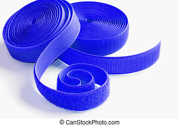 two roll of Velcro on white background