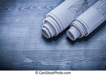 two rolled white blueprints