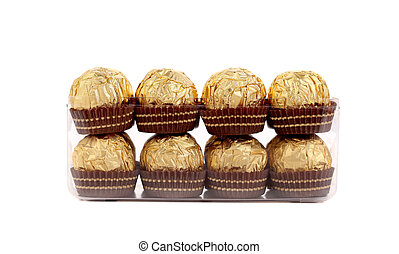 Two rows of gold chocolate bonbons.
