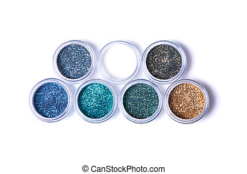 Two rows of metallic glitters in jars
