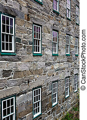 Two rows of windows old stone