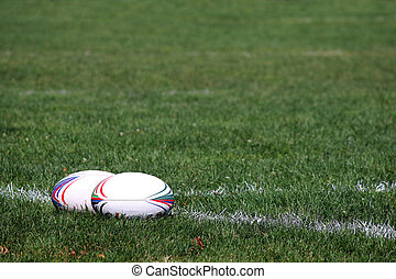 two rugby balls on the field