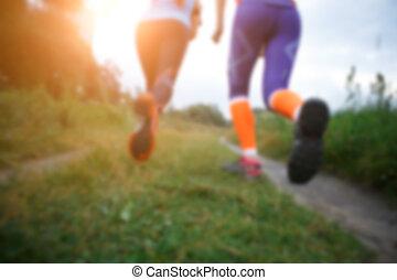Two running women along path