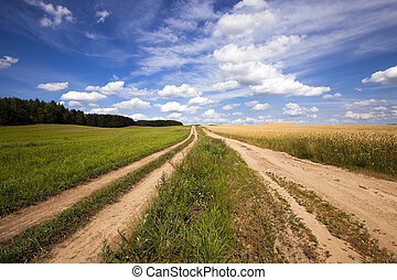 two rural roads - two not asphalted rural roads which are ...