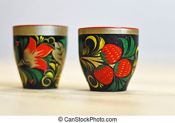 Two Russian traditional wooden cups in the style of Khokhloma