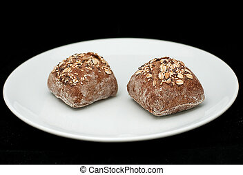 Two rye sandwich buns with cereals
