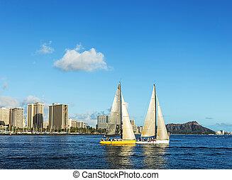 Two sailboat in the sea with Diamond head mountain background, Honolulu Hawaii