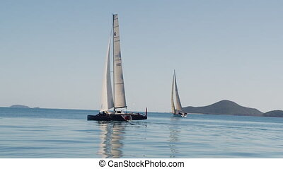 Two sailboats and a stunning ocean - A wide slow motion shot...