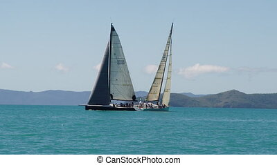 Two sailboats crossing each other