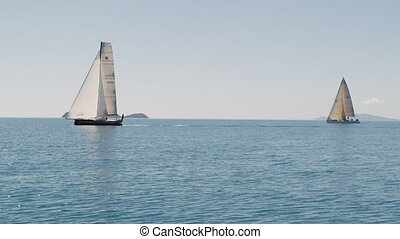 Two sailboats on the ocean