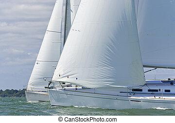 Two Sailing Boats - Two beautiful white yachts sailing close...