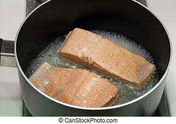 Two Salmon Fillets Poaching - A couple of wild salmon...