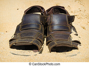 two sandals to sprinkle with sands. Heat summer background -...