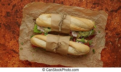 Two sandwiches Baguettes bread with various healthy ...