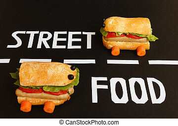 two sandwiches shaped car represent the activity of street f