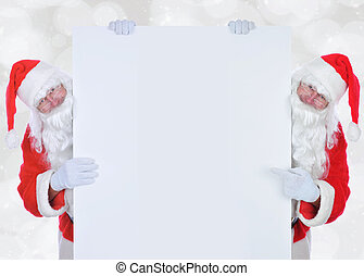 Two Santa Claus on either side of a large blank sign