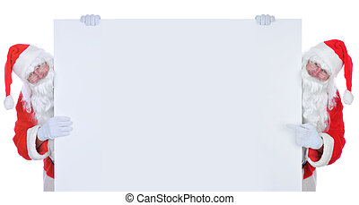 Two Santa Claus on either side of a wide blank poster