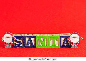 Two santa's with the word santa spelled with colorful alphabet blocks