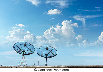 two satellite dish with blue sky