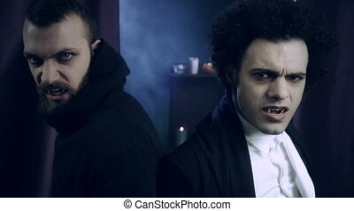 Two scary elegant vampires looking - Two angry hungry ...