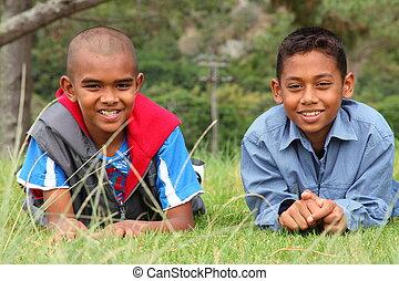 Two school boys in park