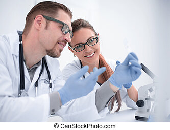 two scientists are conducting tests in the laboratory