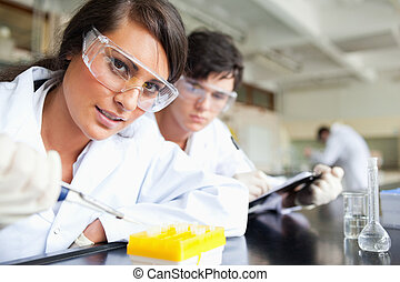 Two scientists making an experiment in a laboratory
