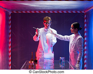 two scientists mixing chemicals in lab