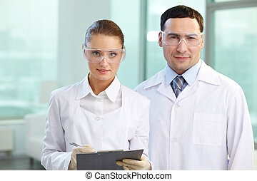 Two scientists - Portrait of two scientists looking at...