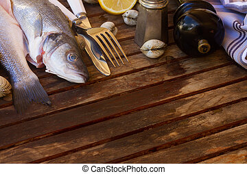Seabass - Two Seabass raw fish with seashells, copy space on...