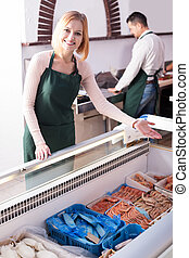 Two sellers in fish store - Portrait of friendly male seller...