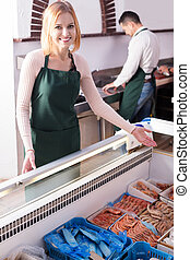 Two sellers in fish store - Portrait of smiling male seller ...