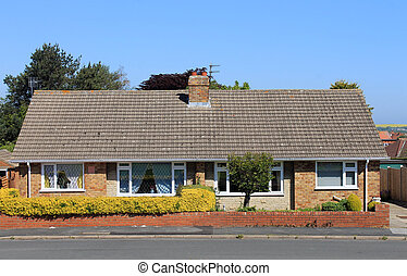 Two semidetached English bungalow houses on estate.