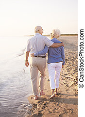 Two senior adults by the ocean