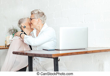 Two senior Business Women friends hugged office after ...