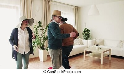 Two senior couples having fun at the party at home. - Two...