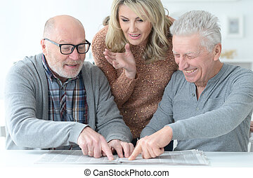 two  Senior men and woman using laptop at home