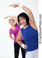 two senior women doing fitness