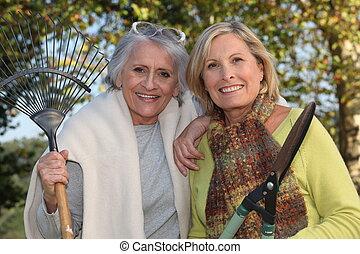Two senior women gardening