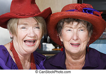 Two Senior Women Wearing Red Hats - Two friendly senior...