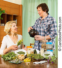 Two seniore women with  herbs