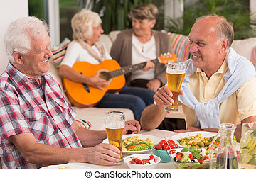 Two seniors drinking beer
