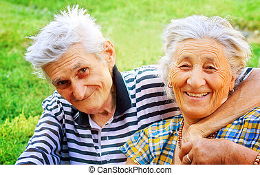 Two seniors in love - Outdoor portrait of two seniors in...