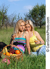 Two sensual blonde with wineglasses