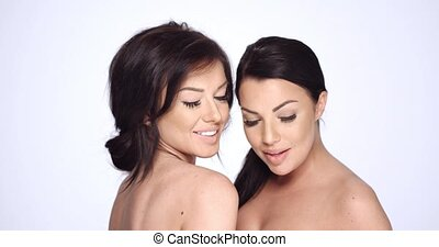 Two Sensual Girls Posing in Studio on White