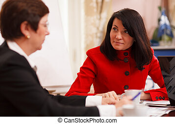 Two serious women in a business meeting