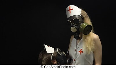 Two sexual nurses in gas mask