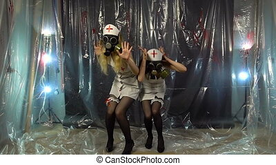 Two sexy dancing girls in costumes - Footage of two dancing...