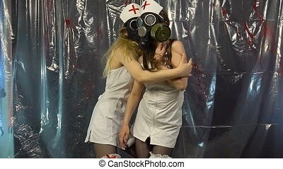 Two sexy dancing girls in gas mask
