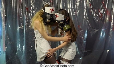 Two sexy dancing nurses in gas mask